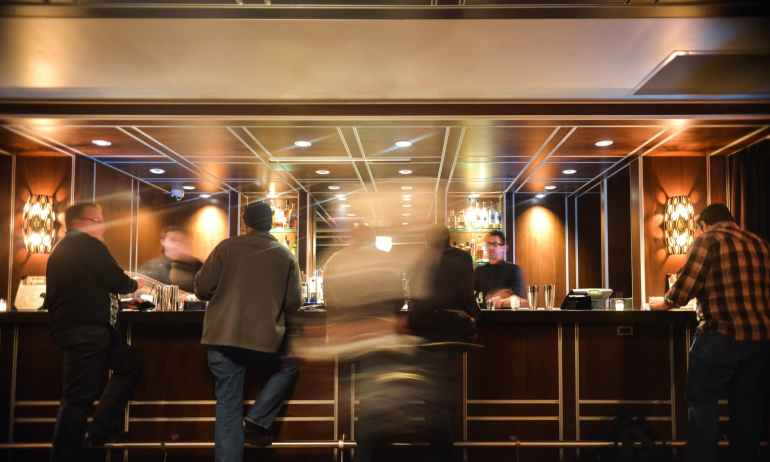 people hotel bar drinks
