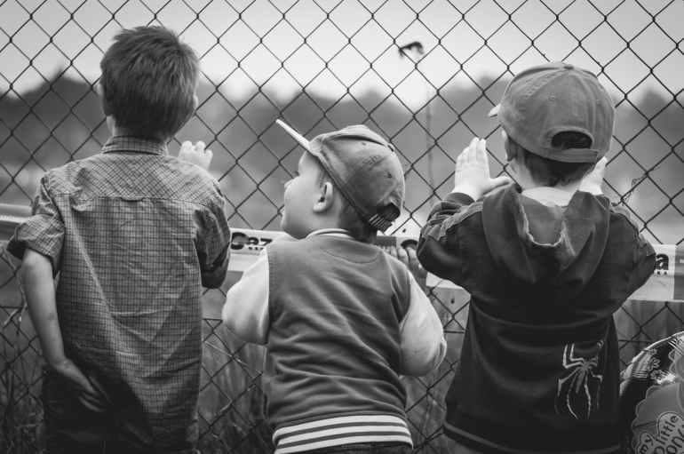 black and white boys children curiosity