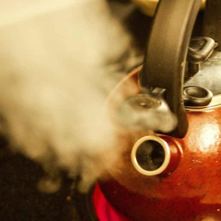 photography of kettle near smoke