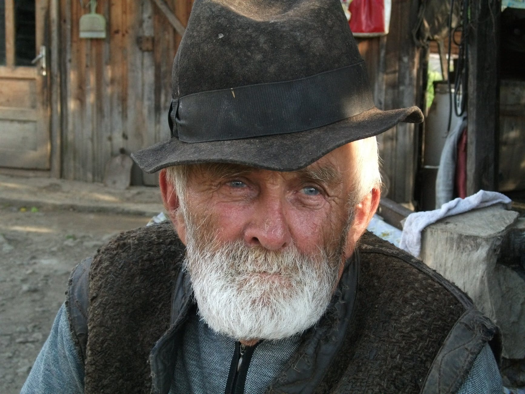 man with white beard wearing black hat during daytime