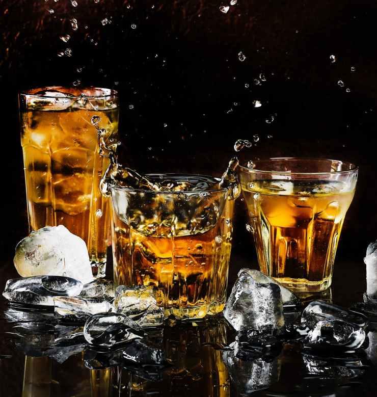 alcohol bar black background close up