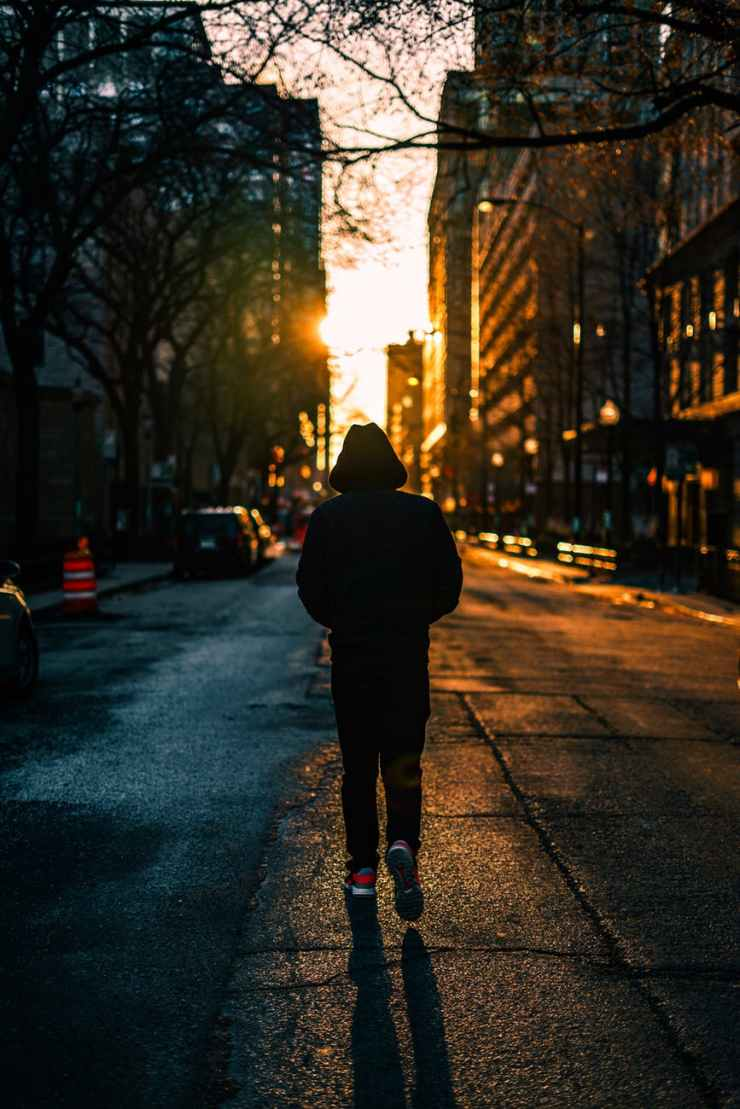 photography of person walking on road
