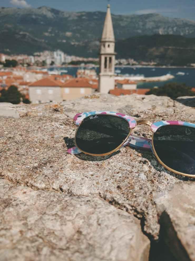 sunglasses on stones