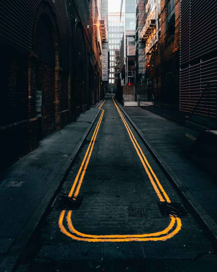 photo of empty alley in between buildings