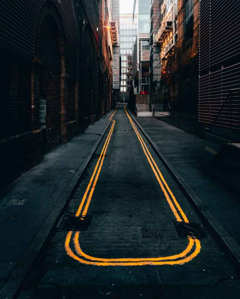 photo of empty alley in between buildings