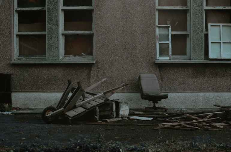 black and gray chair beside brown concrete building